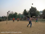 Teenagers playing Sepak takraw